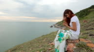 woman use smart phone on mountain
