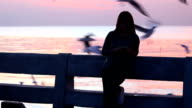 Woman use smartphone to chat my her friend and reading message very happy at sunset Bang Pu Samut Prakan, Thailand