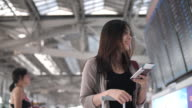 Woman use social media for communication at the airport