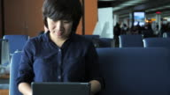Woman use social media for communication on Laptop at the airport