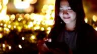 Woman use Tablet at Night and Bokeh