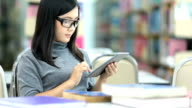 Woman use tablet in the library