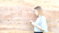 Woman uses smartphone Daytime