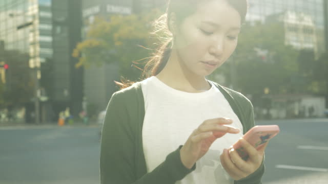 Woman using a smart phone in the city