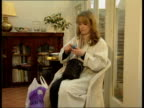 Woman using asthma medicine inhaler