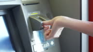 CU TD Woman using ATM, Los Angeles, California, USA