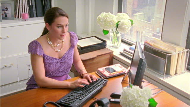 MS HA Woman using computer in office, New York City, New York, USA
