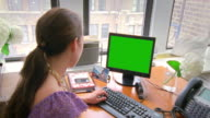 MS Woman using computer in office, New York City, New York, USA