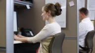 MS ZI Woman using computer in office / Orem, Utah, USA