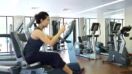 Woman using Digital tablet at gym