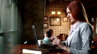 Woman using her laptop in a coffee shop