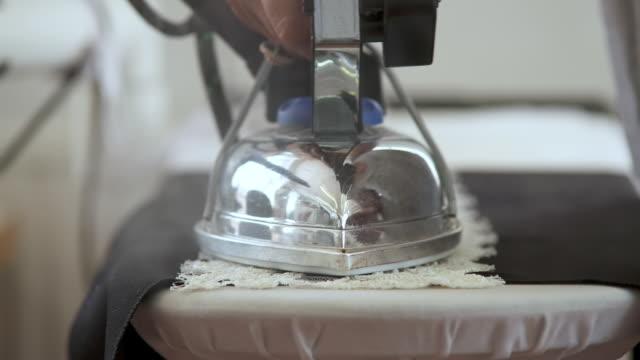 CU Woman using hot iron on beads / United Kingdom