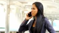 Woman using Mobile Phone.HD format.