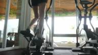 Woman Using Running Machines In Gym