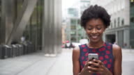 Woman using smart phone responding with smile