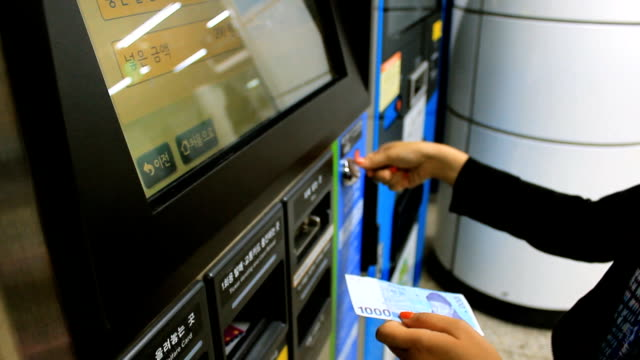 Woman using ticket matchine