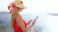Woman using touchpad in Santorini