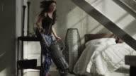 WS Woman vacuuming bedroom / Salt Lake City, Utah, USA