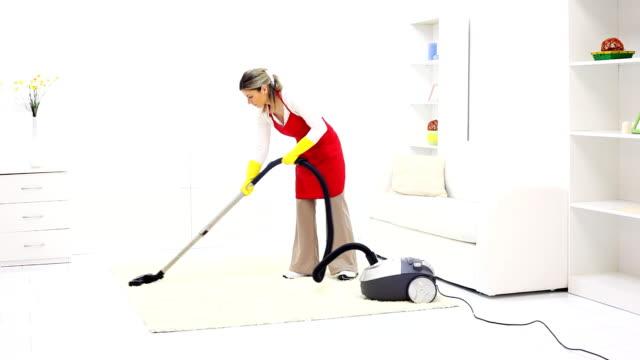 Woman vacuuming her living room.