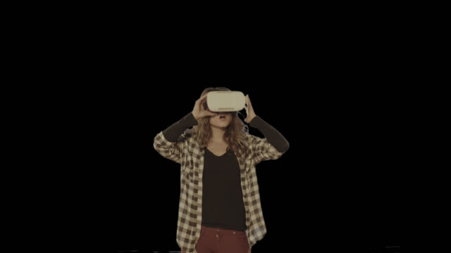 Woman virtual reality headset. Isolated clip alpha channel available in 4k version