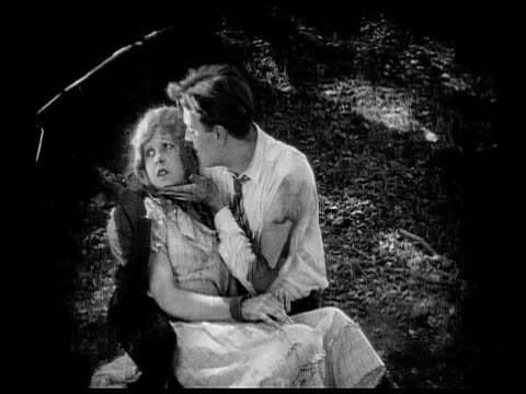 1926 B/W MS Woman (Charlotte Stevens) waking up in arms of man (Robert Gordon) who saved her / USA