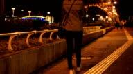 woman walking alone in street night