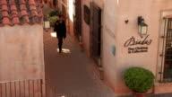MS HA  Woman walking along narrow old town's street, Sedona,  Arizona, USA