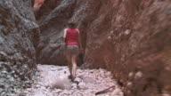 WS TS Woman walking and exploring at Echidna chasm / Purnululu, Western Australia, Australia