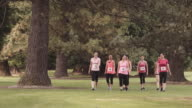 Woman walking for breast cancer awareness