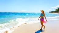 Woman walking in sea