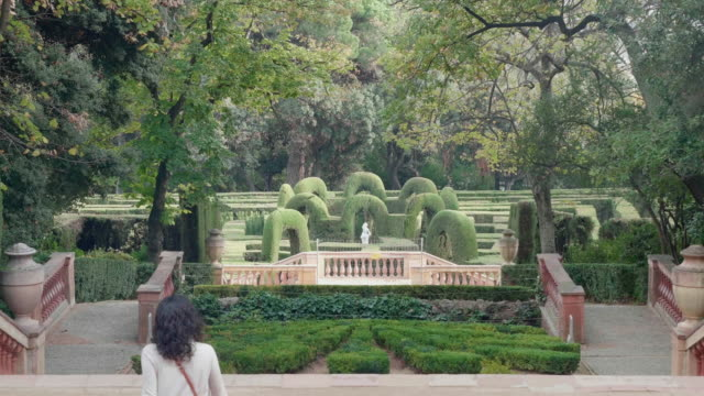 Woman walking in the Labyrinth park in Horta district in Barcelona