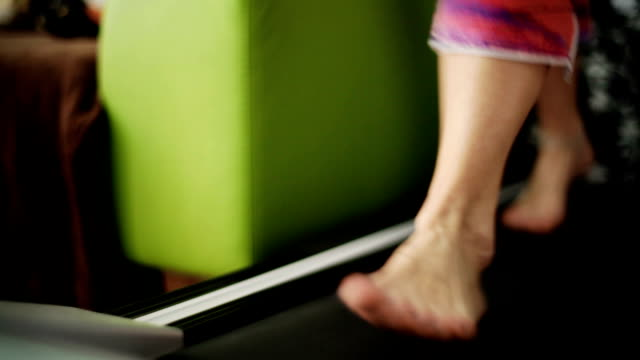 HD: Woman Walking on a Treadmill