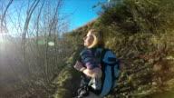 Woman walking on mountain trail