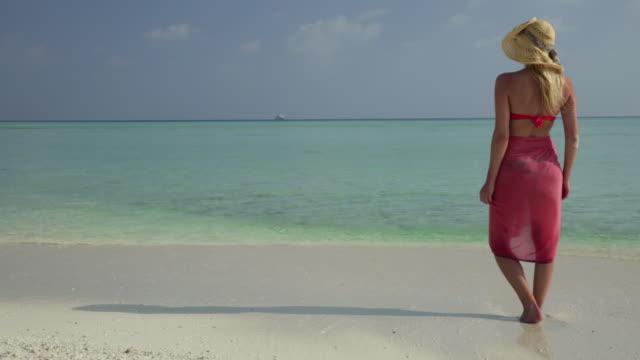 Woman walking on the lagoon