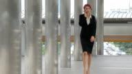 Woman walking talking on mobile phone