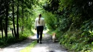 Woman walking the dog.