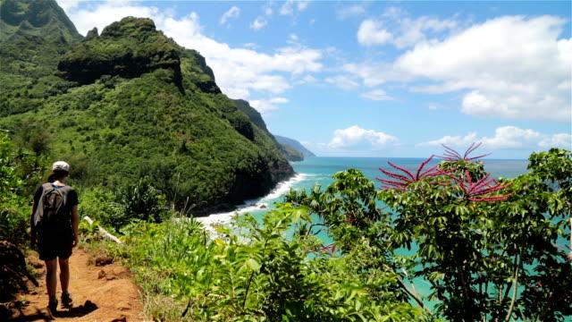 Woman Walking the Kalalau Trail, Napali Coast State Park, Kauai