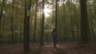 WS Woman walking through autumn forest / Brussels, Belgium