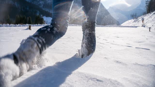 Woman walking through fresh snow