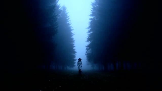 Woman walking through the woods