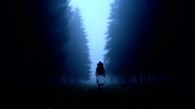 Woman walking through the woods