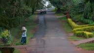 Woman Walking With Goods On Head Mbabane Road  Nairobi  Kenya  Africa