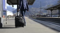 Woman walking with her wheelie suitcase