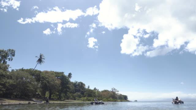 Woman washing clothes at lake Nicaragua at Ometepe island