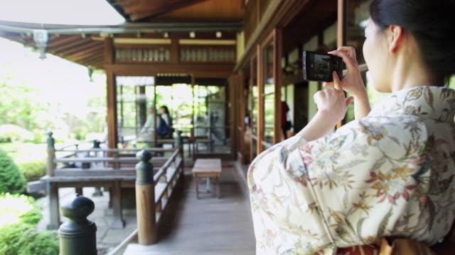 Woman Wearing Kimono Takes Photograph