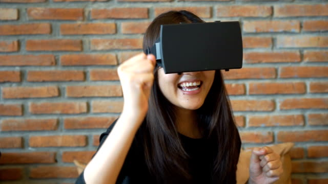 Woman wearing Virtual Reality Headset at Home