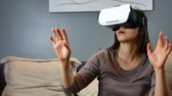 Woman wearing VR Glasses at Home, Virtual Reality