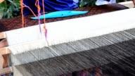 Woman weaving Thai silk