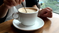 A woman who drinks coffee
