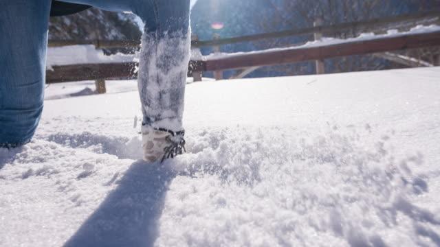 Woman winter hiking in fresh snow